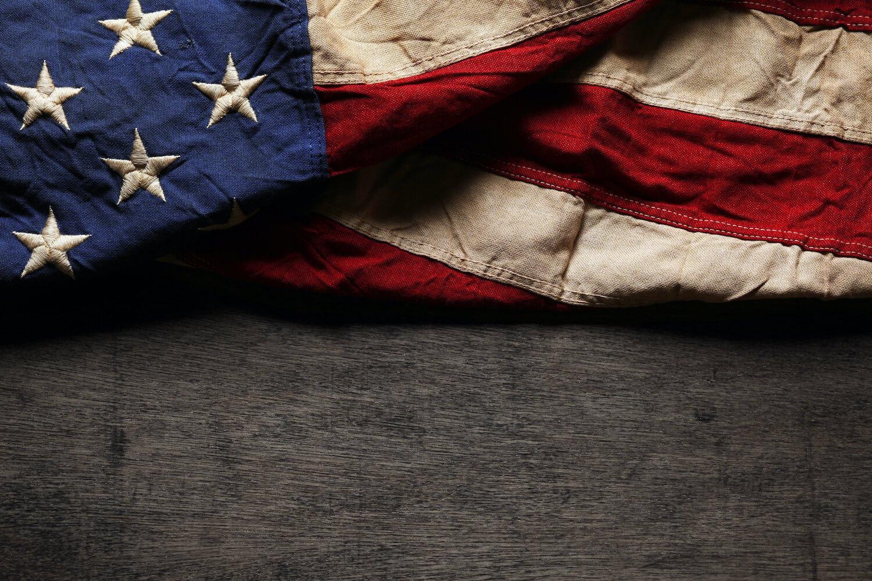 American flag on dark wood background_Depositphotos_75369833_xl-2015 (1) (2)