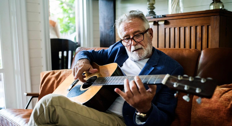 Senior Playing Guitar