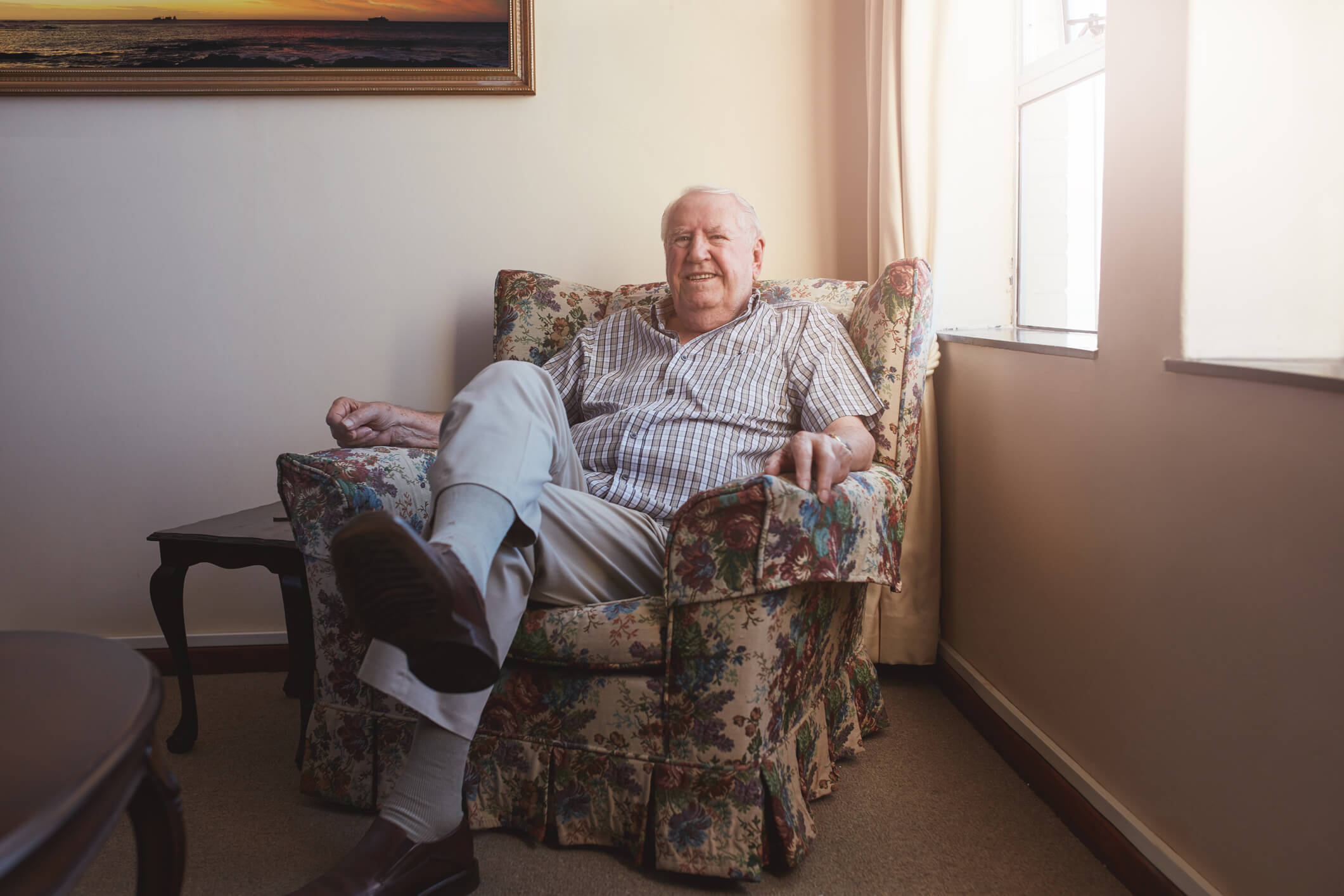 A Senior Gentleman in a Love Seat